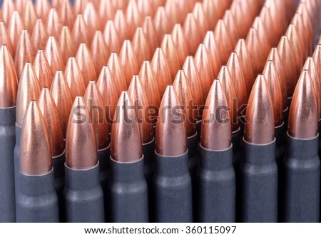Live ammunition for automatic weapons or rifles ranked diagonally closeup. - stock photo