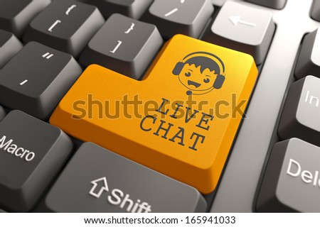 Live Chat Concept. Boy with Headset Icon on Orange Keyboard Button. - stock photo