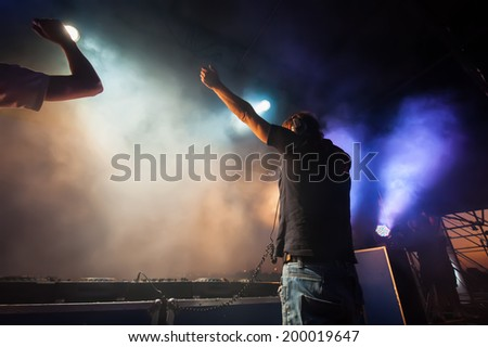 live DJ music in a nightclub on a background of light effects - stock photo