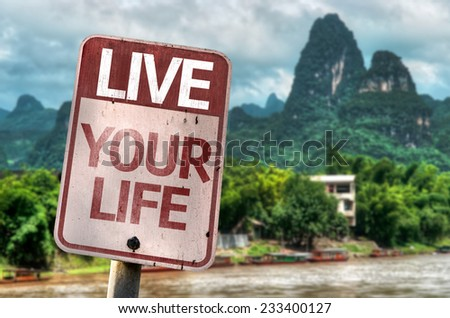 Live Your Life sign with a exotic landscape on background - stock photo