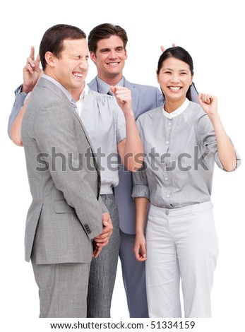 Lively business team having fun together against a white background - stock photo