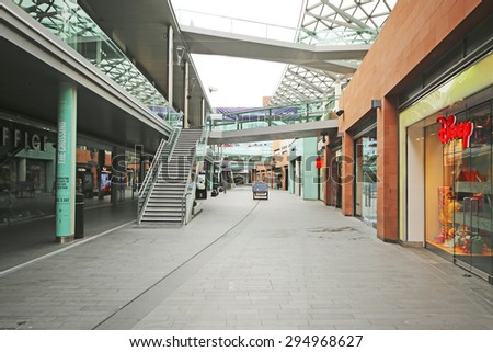 LIVERPOOL, ENGLAND - JULY 5, 2015: Retail shops. Liverpool ONE, in the heart of the city, is the huge open-air shopping district that is home to more than 160 famous high street and designer names - stock photo