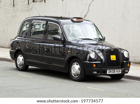 Liverpool, England - July 12, 2011: Typical british taxi cab manufactured by LTI (London Taxi International) parked in a Liverpool side street.  - stock photo