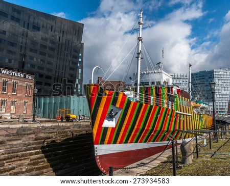 Liverpool, UK - April 4th, 2015: A boat with dazzle designs for the 1418 NOW WW1 Centenary Art Commission, Liverpool Biennial and Tate painted by artist Carlos Cruz-Diez. - stock photo