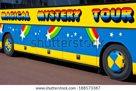 LIVERPOOL, UK - APRIL 15TH 2014: A Magical Mystery Tour bus in Liverpool used to take tourists around to see all of 'The Beatles' landmarks on 15th April 2014. - stock photo