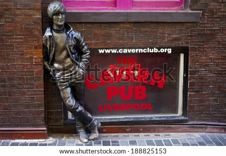 LIVERPOOL, UK - APRIL 18TH 2014: A statue of John Lennon opposite the historic Cavern Club in Liverpool's Mathew Street on 18th April 2014. - stock photo