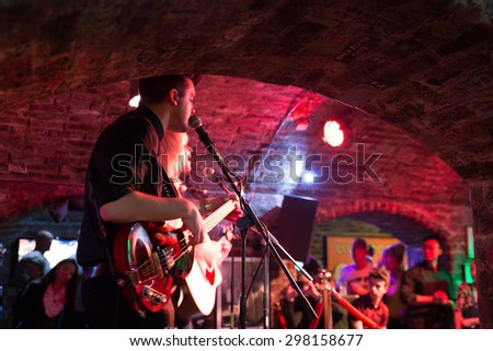 LIVERPOOL, UNITED KINGDOM - OCTOBER 11, 2014: Band performs to audience inside the historic Cavern Club in Liverpool. - stock photo