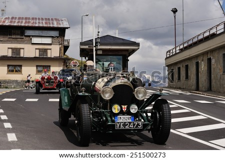 LIVIGNO, ITALY - JUNE 13: A green Bentley 3 Litre takes part to the Summer Marathon classic car race on June 13, 2014 in Livigno. This car was built in 1925 - stock photo
