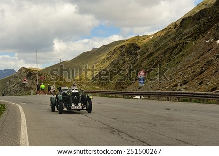 LIVIGNO, ITALY - JUNE 13: A green Lagonda M45 Rapide takes part to the Summer Marathon classic car race on June 13, 2014 in Livigno. This car was built in 1935 - stock photo