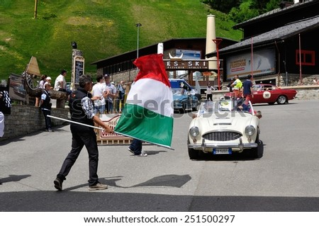 LIVIGNO, ITALY - JUNE 13: A white Austin Healey 3000 MK1 starts the Summer Marathon classic car race on June 13, 2014 in Livigno. This car was built in 1961 - stock photo