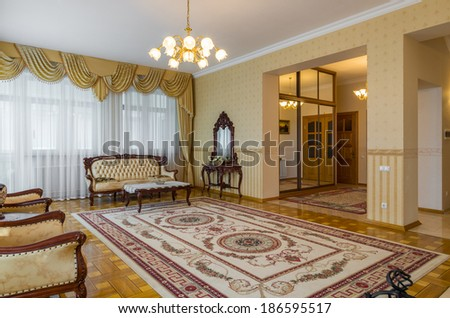Living room classicism yellow interior with carpet - stock photo