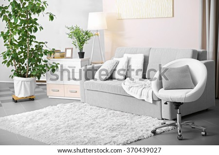 Living room design with armchair and sofa - stock photo