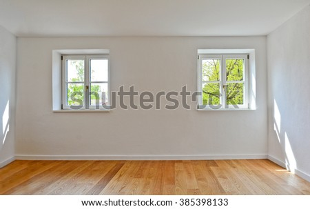 Living room in an old building - Apartment with wooden windows and parquet flooring - stock photo