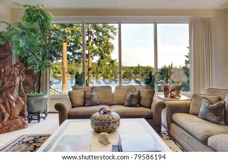 Living Room  in Luxurious New Home with View of Lake - stock photo