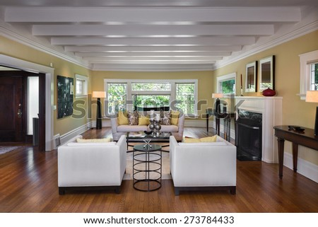 Living room in Luxury home with fire place and gorgeous, high coffered ceilings. - stock photo