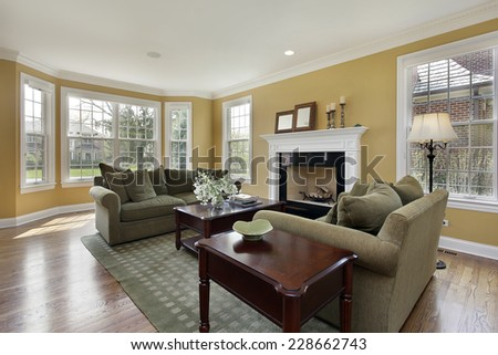 Living room in luxury home with fireplace - stock photo