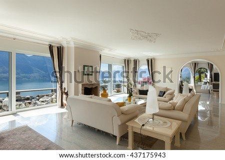 living room in luxury house, comfortable white divans  - stock photo