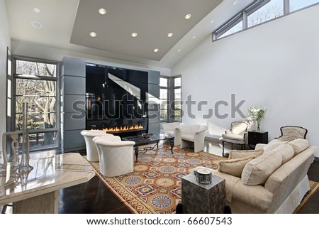 Living room in modern home with glass fireplace - stock photo