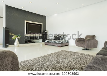 Living room in modern style in the residence - stock photo
