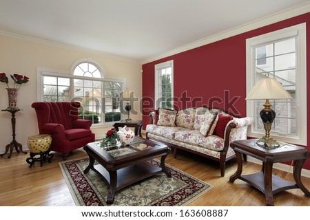 Living room in suburban home with red and cream colored walls - stock photo