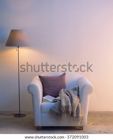 living room interior with chair and pillow - stock photo