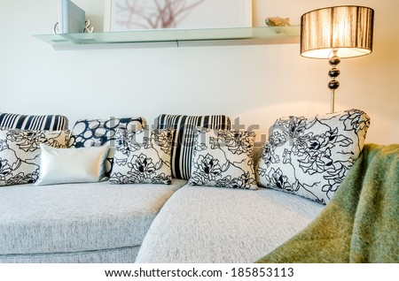 Living room Interior with couch, sofa and colorful designer cushions, pillows - stock photo