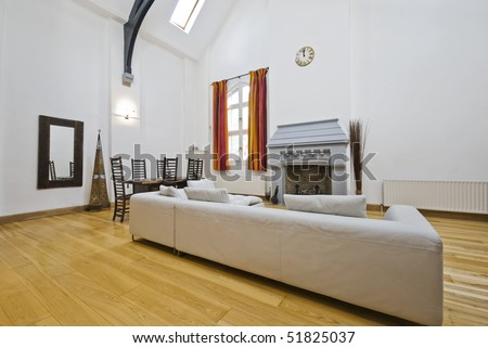living room interior with double height ceiling and roof windows - stock photo