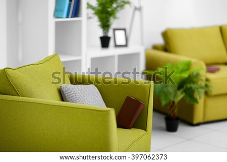 Living room interior with green furniture on light background - stock photo