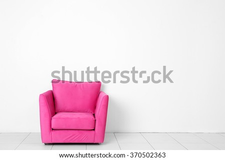 Living room interior with pink armchair on white wall background - stock photo