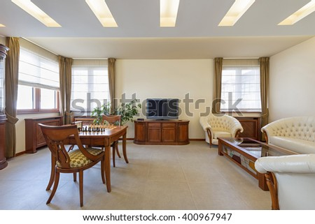 Living room interior with wooden furniture - stock photo