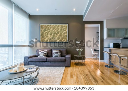 living room with big window and brown wall interior - stock photo