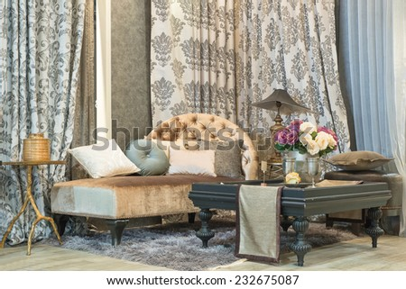 living room with classic looking sofa, luxury curtains, lamp and glass table - stock photo