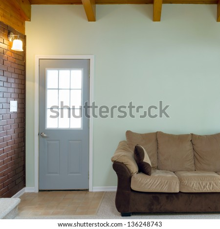 Living room with furnishings in a new home - stock photo