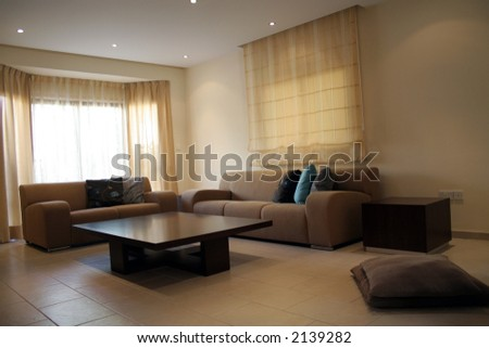 Living room with modern coffee table and sofa - stock photo