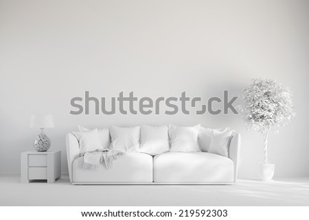 Living room with sofa in front of a wall in white - stock photo