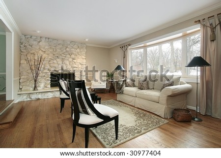 Living room with stone fireplace - stock photo