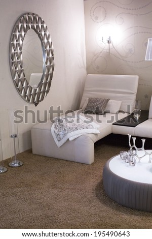 living room with white furniture, mirror and brown carpet - stock photo