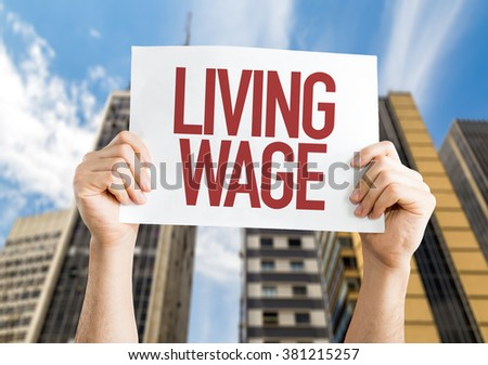 Living Wage placard with urban background - stock photo
