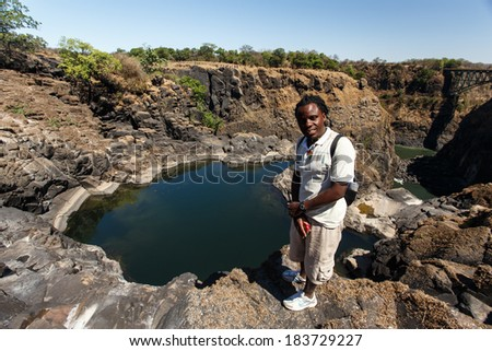 LIVINGSTONE - OCTOBER 01 2013: Guide shows the landscapes of the Zambezi River area in Livingstone, Zambia, Africa - stock photo