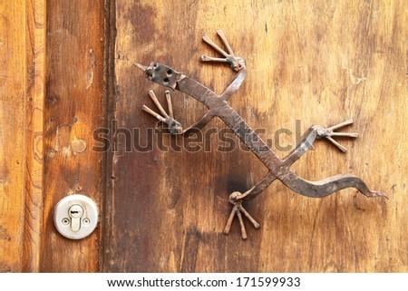 Lizard handle on a door - stock photo