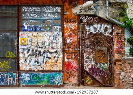 LJUBLJANA, SLOVENIA - APRIL 17: Graffitti on a wall and door in squat located in Metelkova street in Ljubljana, Slovenia on April 17, 2014. - stock photo