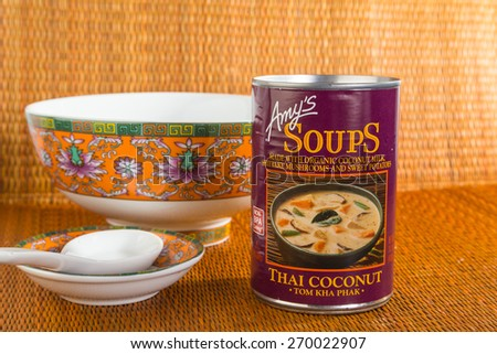 "LLANO, TEXAS-APR 16, 2015: Can of ""Amy's Thai Coconut Soup"" on bamboo mat background with Oriental Dishes for emphasis. - stock photo"
