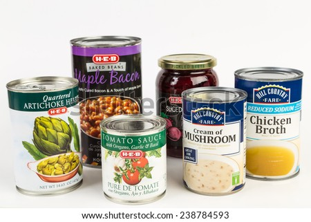 "LLANO, TEXAS-DEC 18, 2014:  Assortment of ""Store Brand"" products on white background.  Buying the ""Store Brand"" offers considerable savings with little loss in quality. - stock photo"