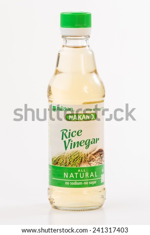 LLANO, TEXAS-Jan 03, 2015:  Bottle of Nakano All Natural Rice Vinegar by Mizkan against white background.  Oriental Cooking Seasoning. - stock photo