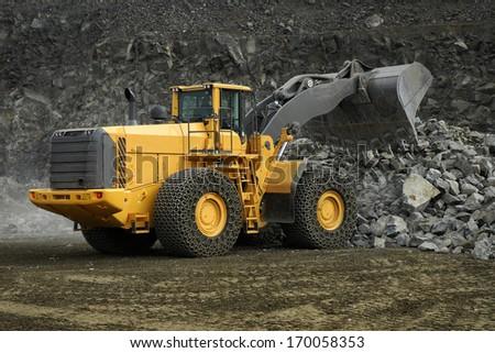 Loader construction machine in mine stone - stock photo