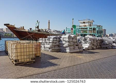 Loading a ship in Port Said  in Dubai, UAE. - stock photo