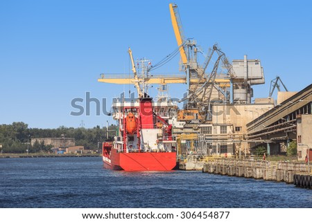 Loading phosphate fertilizers in the port of Gdansk, Poland. - stock photo
