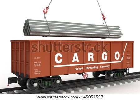 Loading pipes in the wagon. - stock photo