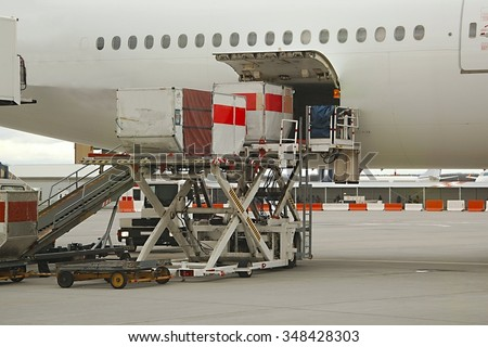 Loading Plane Cargo Hold - stock photo