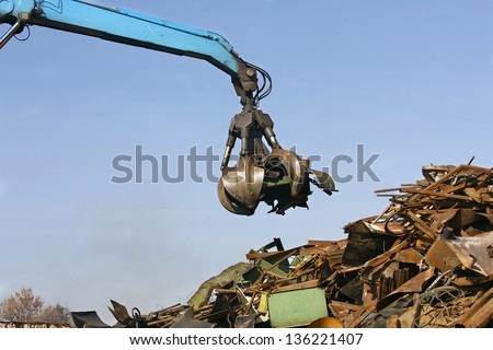 Loads of metal waste on the junkyard , to be recycled - stock photo